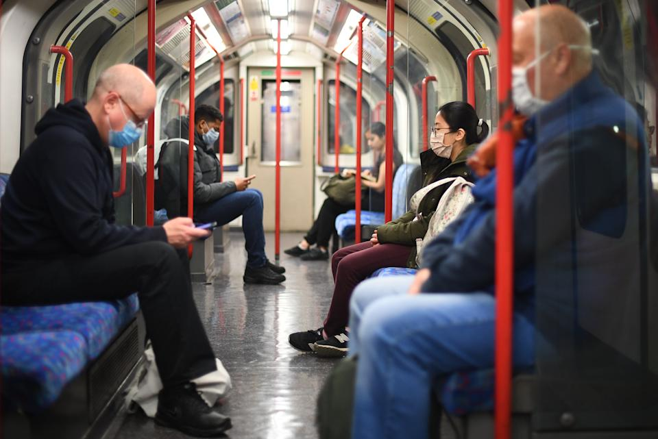 File photo dated 13/05/20 of passengers wearing face masks on a Central Line underground train in London, after the announcement of plans to bring the country out of lockdown. There was a 10% increase in London Underground journeys early on Thursday compared with the same period last week, Transport for London (TfL) said.