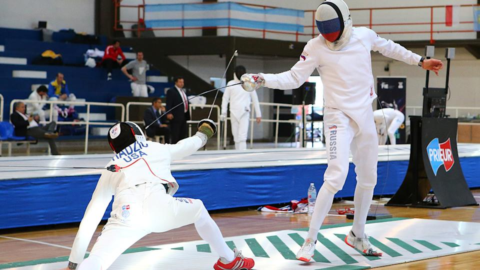 Alen Hadzic, pictured here in action against Vadim Anokhin at the Men's Epee World Cup in 2019.