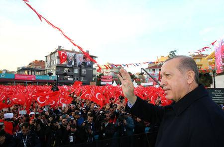 Turkish President Tayyip Erdogan greets his supporters during an opening ceremony of a new metro line in Istanbul, Turkey December 15, 2017. Kayhan Ozer/Presidential Palace/Handout via REUTERS