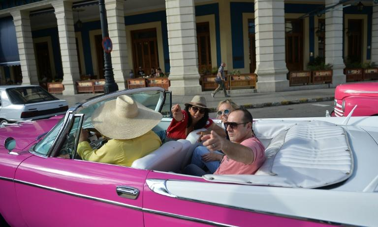 Despite Donald Trump's measures, tourists still flock to Cuba to ride in 1950s convertibles and enjoy sandy beaches