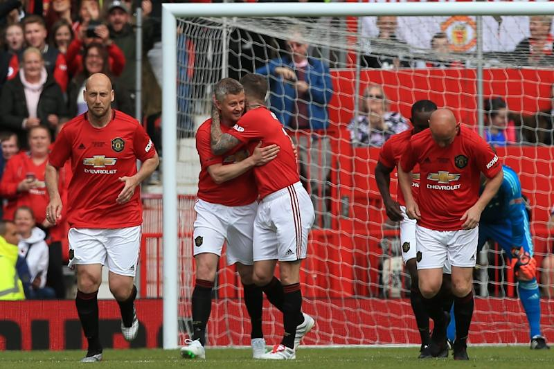 Manchester United '99 Legends celebrate a goal against Bayern Munich in a charity match (AFP Photo/Lindsey PARNABY)