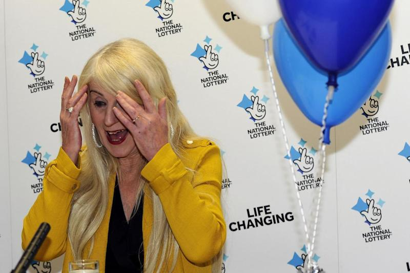 Taxi driver Melissa Ede, 57, celebrating during a photocall at Willerby Manor Hotel in Hull. (PA)