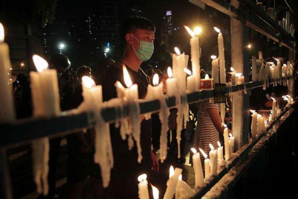 PHOTO: People light candles during a vigil for those killed during the 1989 Tiananmen Square protests at Victoria Park in Causeway Bay, Hong Kong, on June 4, 2020, despite applications for it being officially denied. (Kin Cheung/AP)