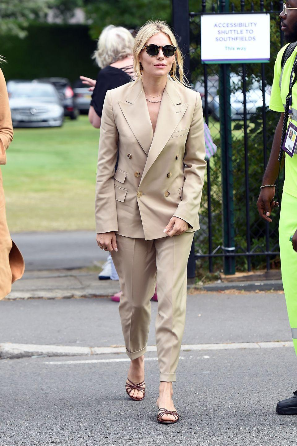 <p>The actress had tonal dressing down to a tee as she arrived at Wimbledon in a Ralph Lauren Collection beige suit and brown sandals. </p>