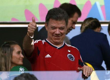 Colombia President Juan Manuel Santos gives a thumbs up during the 2014 World Cup quarter-finals between Brazil and Colombia at the Castelao arena