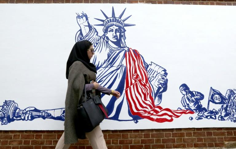 Iran unveiled new anti-American murals on the walls of the former US embassy ahead of the 40th anniversary of the Tehran hostage crisis (AFP Photo/ATTA KENARE)
