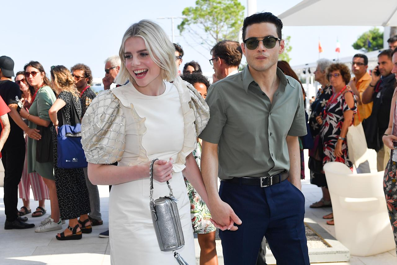 """<p>With the release of the critically-acclaimed film Bohemian Rhapsody came <a href=""""https://www.elle.com/uk/life-and-culture/a26503795/lady-gaga-rami-malek-oscars/"""" target=""""_blank"""">Rami Malek</a> and <a href=""""https://www.elle.com/uk/beauty/make-up/g26493693/lucy-boynton-make-up/"""" target=""""_blank"""">Lucy Boynton</a>: The two lead actors whose relationship blossomed alongside their award-winning movie roles.</p><p>The couple turned heads <a href=""""https://www.elle.com/uk/awards-season-best-fashion-makeup-hair/"""" target=""""_blank"""">during the 2019 awards season </a>with their combined effortlessly cool style complimenting their sweet moments of interaction, most memorably when Malek was awarded the Oscar for best actor and instinctively grabbed and kissed his girlfriend with joy.</p><p>The speech then cemented his public devotion to Boynton, as he utilised his winning moment to pay homage to Boynton, saying: 'You're the heart of this film, you are beyond immensely talented, you have captured my heart.'</p><p>Though the couple haven't been pictured as much since the first few months of the year, their relationship continues to go from strength to strength with their most recent joint appearance occurring at the <a href=""""https://www.elle.com/uk/fashion/celebrity-style/g28853098/venice-film-festival-red-carpet/"""" target=""""_blank"""">Venice Film Festival.</a></p><p>Individually, Boynton and Malek are capitalising on the success of Bohemian Rhapsody too, with exciting upcoming projects including <a href=""""https://www.elle.com/uk/life-and-culture/a28405228/who-is-next-james-bond/"""" target=""""_blank"""">a Bond villain role for Malek</a> and Boynton's part in the<a href=""""https://www.elle.com/uk/life-and-culture/a28656845/the-politician-netflix/"""" target=""""_blank""""> hugely anticipated Netflix series from Ryan Murphy, </a><a href=""""https://www.elle.com/uk/life-and-culture/a28656845/the-politician-netflix/"""" target=""""_blank"""">The Politician.</a></p><p>We take a look back at their most head-turning looks, """