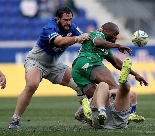 HARRISON, NJ - MARCH 12: Topsy Ojo #11 of London Irish loses the ball as Juan Figallo #3 of Saracens defends during the Aviva Premiership match on March 12, 2016 at Red Bull Arena in Harrison, New Jersey. (Photo by Elsa/Getty Images)