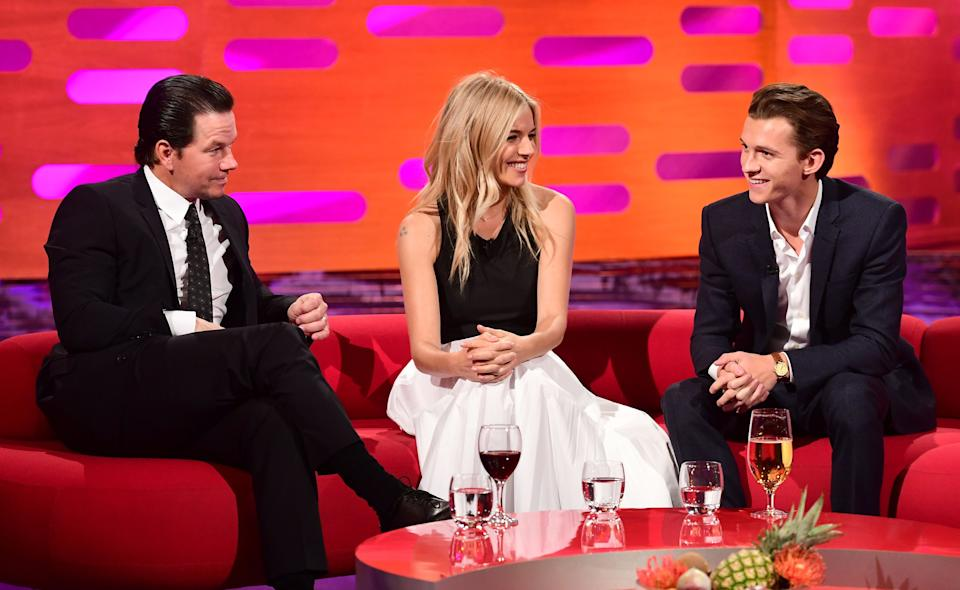 (left to right) Mark Wahlberg, Sienna Miller and Tom Holland during filming of the Graham Norton Show at the London Studios, to be aired on BBC One on Friday evening. (Photo by Ian West/PA Images via Getty Images)