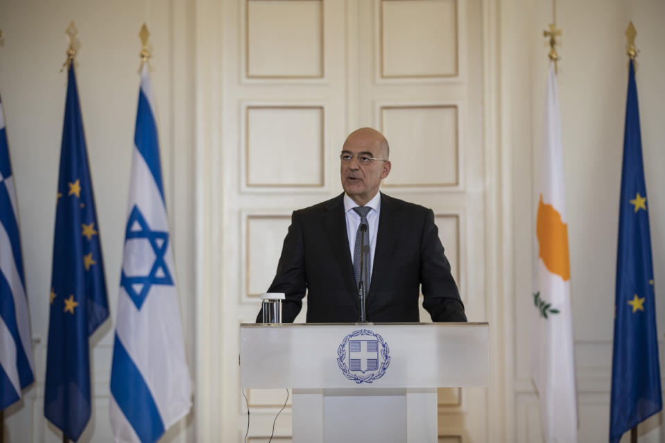Greek Foreign Minister Nikos Dendias speaks during a join news conference with Israel's counterpart Gabi Ashkenazi and Cypriot Foreign Minister Nikos Christodoulides after a meeting between the foreign Ministers of Greece , Israel and Cyprus in Athens, on Tuesday, Oct. 27, 2020. (AP Photo/Petros Giannakouris)