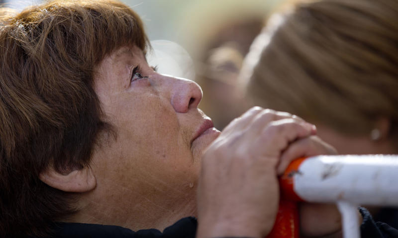 Victoria Sanchez, a supporter of Argentina's President Cristina Fernandez, cries outside the Favaloro Hospital where Fernandez is undergoing surgery on her skull months after she suffered an unexplained head injury in Buenos Aires, Argentina, Tuesday, Oct. 8, 2013. Dozens of supporters of Argentina's leader gather outside the Fundacion Favaloro, one of Argentina's top cardiology hospitals, after keeping vigil there the night before. (AP Photo/Natacha Pisarenko)