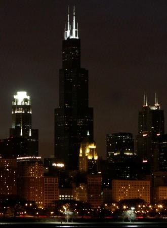 """FILE PHOTO: The Sears Tower is shown in the skyline of downtown Chicago shortly before the city participated in """"Earth Hour\"""