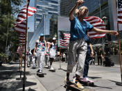 Members of the first U.S. Olympic skateboarding team arrive on their boards for a news conference in downtown Los Angeles on Monday, June 21, 2021. The team was introduced in Southern California, where the sport was invented roughly 70 years ago. Skateboarding is an Olympic sport for the first time in Tokyo, and the Americans are expected to be a strong team. (AP Photo/Richard Vogel)