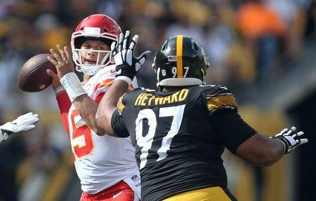 Sep 16, 2018; Pittsburgh, PA, USA; Kansas City Chiefs quarterback Patrick Mahomes (15) passes against pressure from Pittsburgh Steelers defensive tackle Cameron Heyward (97) during the fourth quarter at Heinz Field. Kansas City won 42-37. Mandatory Credit: Charles LeClaire-USA TODAY Sports