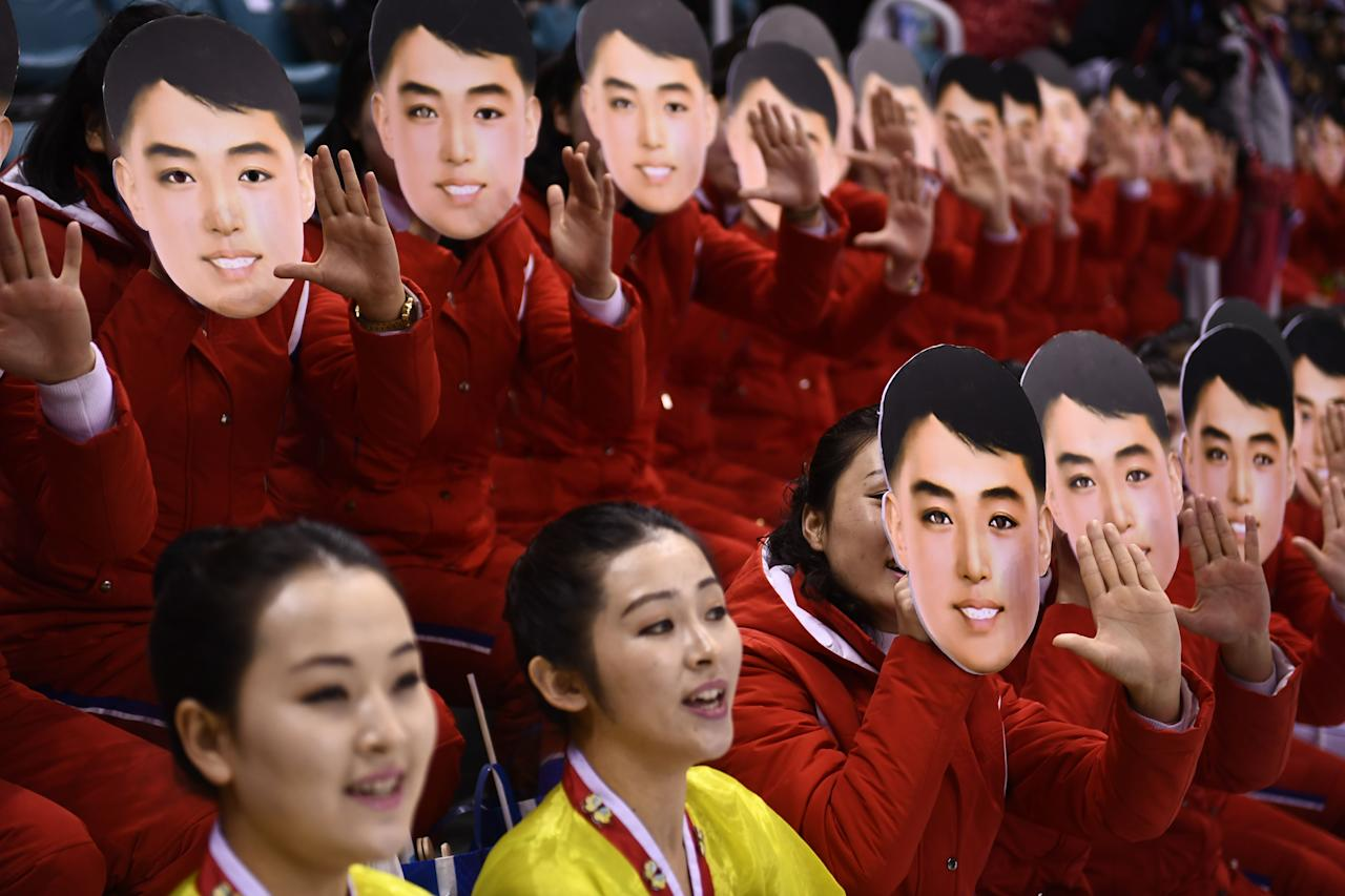 <p>North Korean cheerleaders cheer during the women's preliminary round ice hockey match between Switzerland and the Unified Korean team during the Pyeongchang 2018 Winter Olympic Games at the Kwandong Hockey Centre in Gangneung on February 10, 2018. </p>