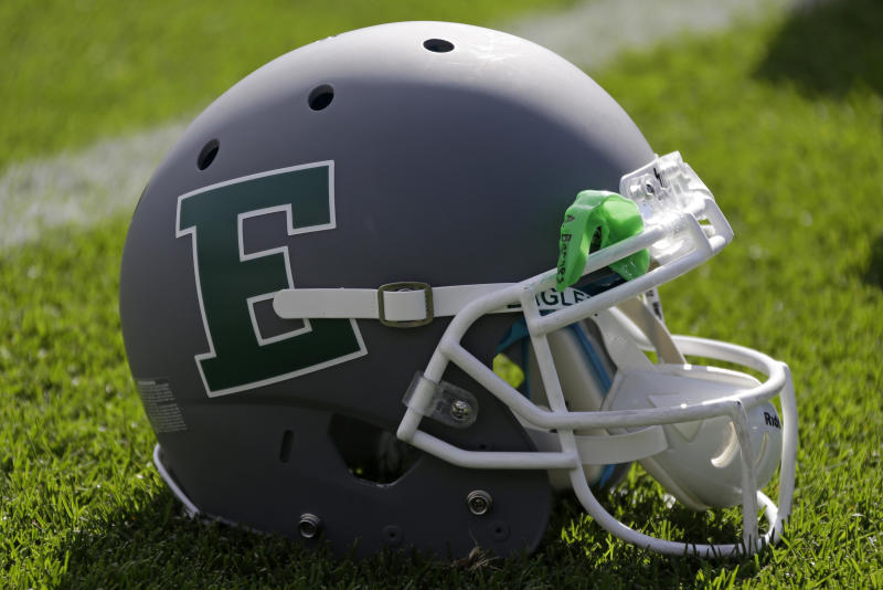 This is an Eastern Michigan football helmet on the turf at Beaver Stadium before an NCAA college football game between Penn State and Eastern Michigan in State College, Pa., Saturday, Sept. 7, 2013. (AP Photo/Gene J. Puskar)