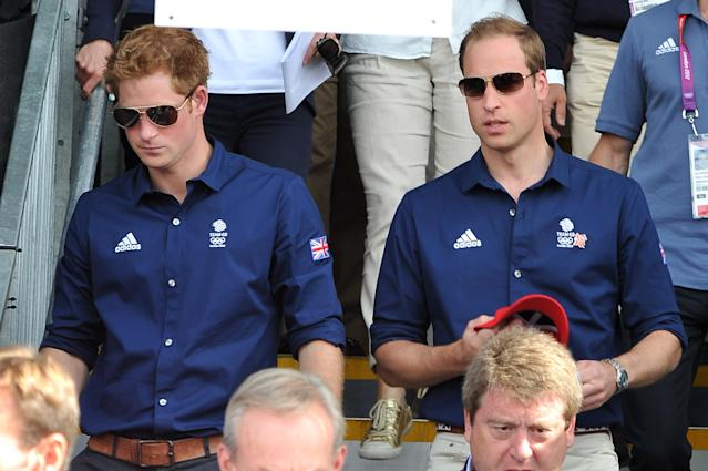Prince Harry (L) and Prince William, Duke of Cambridge attend the Eventing Cross Country Equestrian event on Day 3 of the London 2012 Olympic Games at Greenwich Park on July 30, 2012 in London, England. (Photo by Pascal Le Segretain/Getty Images)