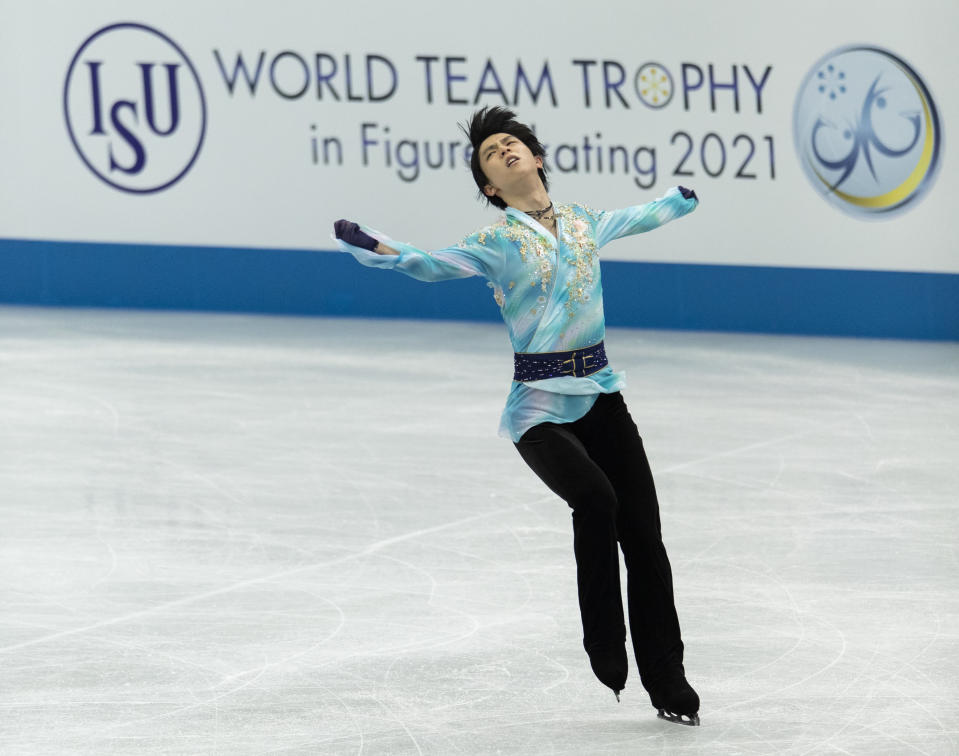 Japan's Yuzuru Hanyu performs during the men's free skating program of the ISU World Team Trophy figure skating competition in Osaka, western Japan, Friday, April 16, 2021. (AP Photo/Hiro Komae)