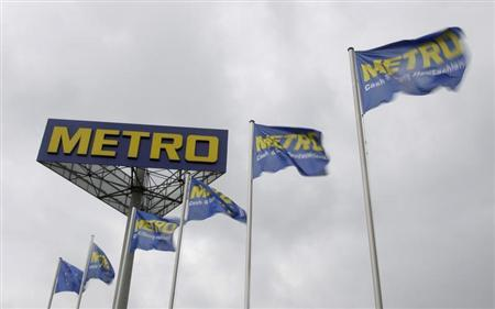 Company flags are pictured next to a Metro warehouse in Berlin