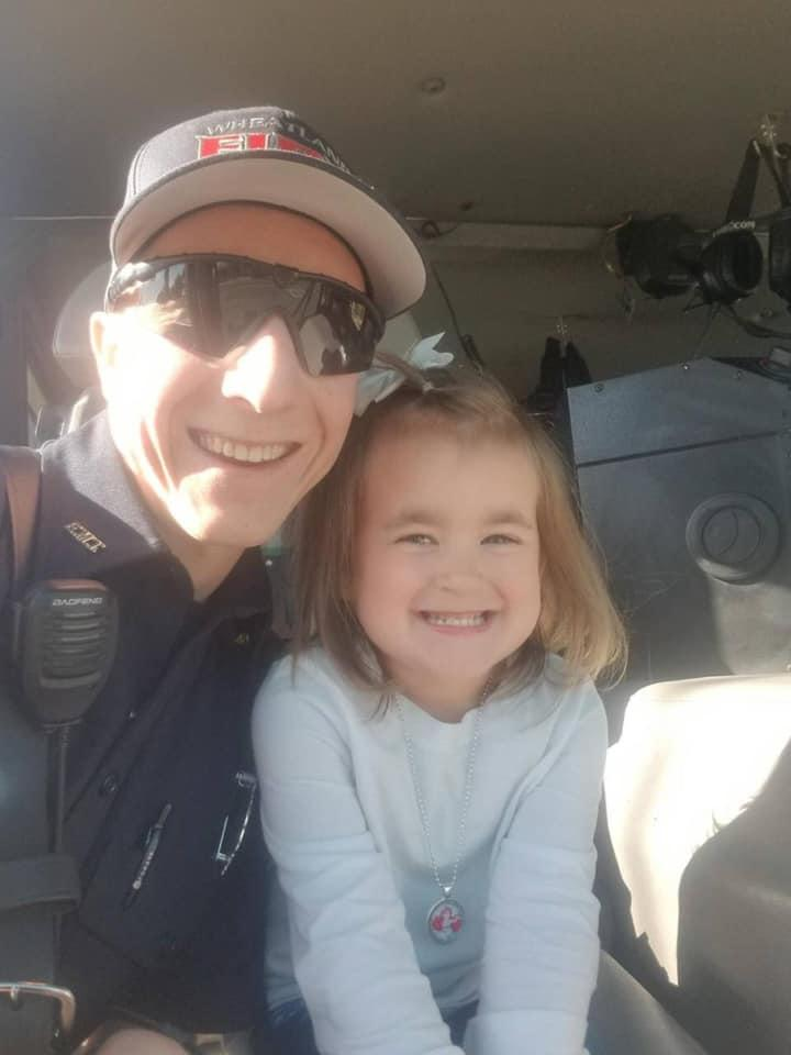 Anthony Banas from Wheatland Fire Authority with autistic girl Kayli, 3, after photo of them hugging went viral.