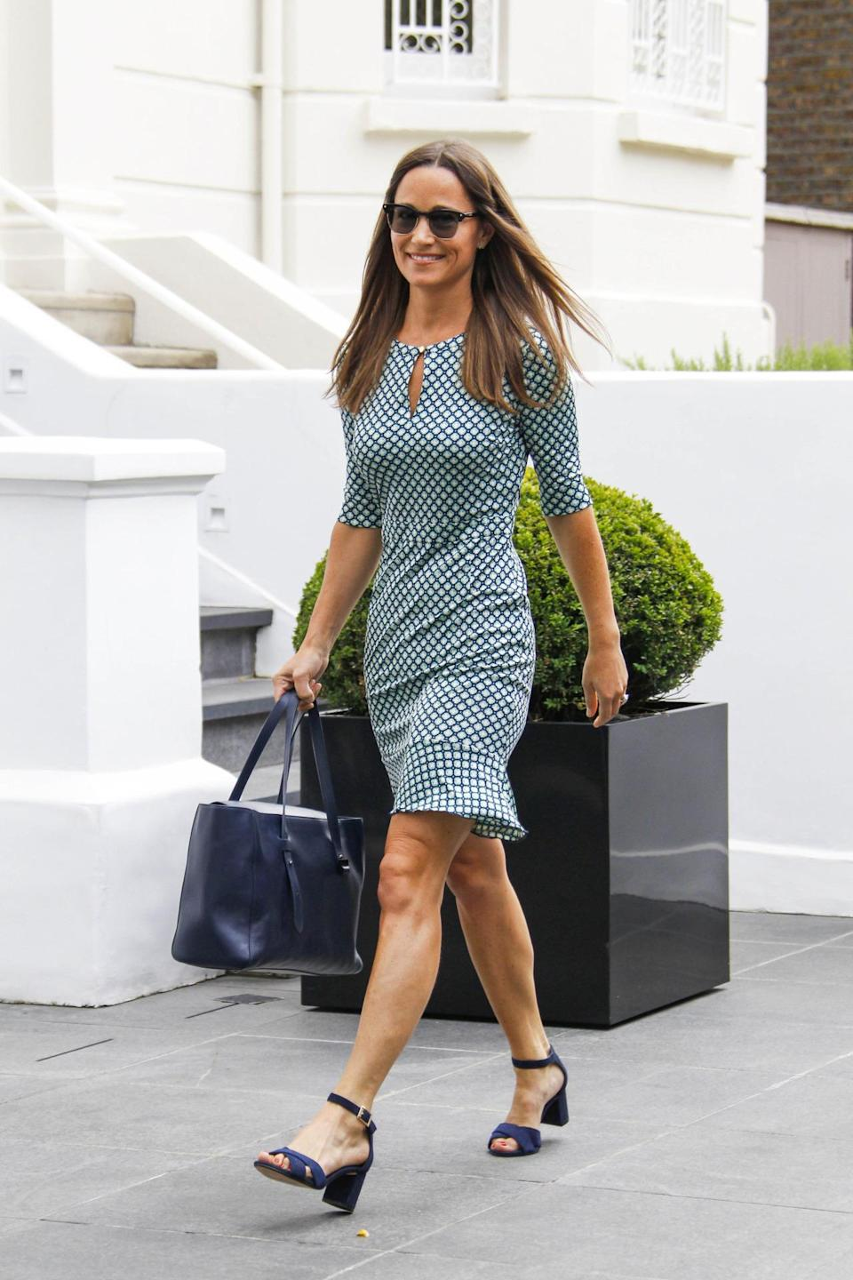 <p>Pippa opted for printed polka dot dress and chunky block sandals for a day in London. <i>[Photo: FameFlynet]</i> </p>