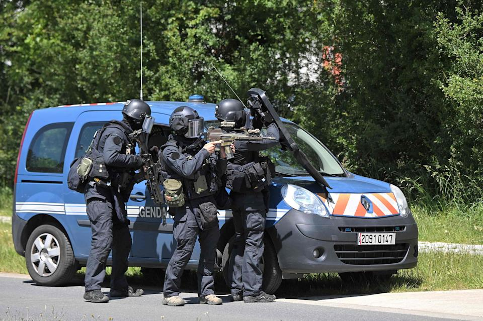 <p>Members of the National Gendarmerie Intervention Group (GIGN) are seen after a municipal policewoman was attacked with a knife in La Chapelle-sur-Erdre, near Nantes, western France. </p> (AFP via Getty Images)
