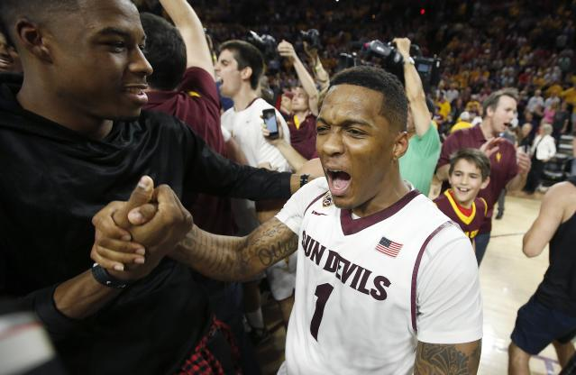 Arizona State's Jahii Carson (1) celebrates on the court after an NCAA college basketball game win against Arizona, Friday, Feb. 14, 2014, in Tempe, Ariz. Arizona State defeated Arizona 69-66 in double overtime. (AP Photo/Ross D. Franklin)