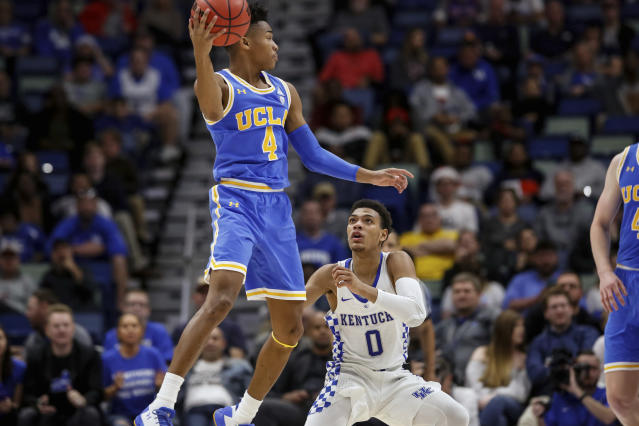 UCLA guard Jaylen Hands (4) looks to pass against Kentucky guard Quade Green (0) in the second half of an NCAA basketball game in New Orleans, Saturday, Dec. 23, 2017. UCLA won 83-75. (AP Photo/Scott Threlkeld)