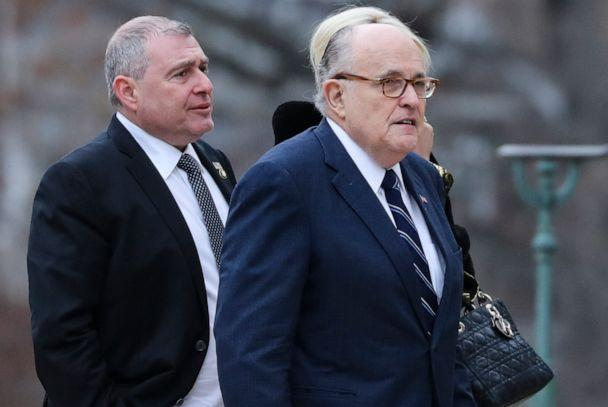 PHOTO: Lawyer for President Donald Trump, Rudy Giuliani, center, and Lev Parnas, left, arrive for the funeral of former president George H.W. Bush at the National Cathedral in Washington on Dec. 5, 2018. (Alex Edelman/AFP via Getty Images, FILE)
