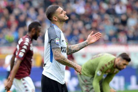 FILE PHOTO: Soccer Football - Serie A - Torino vs Inter Milan - Stadio Olimpico Grande Torino, Turin, Italy - April 8, 2018 Inter Milan's Mauro Icardi reacts after a missed chance REUTERS/Massimo Pinca
