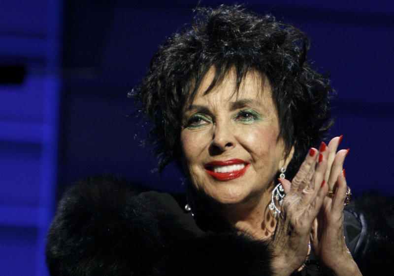 FILE - In this Sept. 25, 2008 file photo, Elizabeth Taylor speaks during the 26th Annual Macy's Passport to Fashion gala in Santa Monica, Calif. Family and friends of Taylor gathered on the Warner Bros. lot on Sunday, Oct. 16, 2011, for a private memorial service seven months after the death of the Hollywood legend to commemorate her life and career, some of which played out at the studio.  (AP Photo/Matt Sayles, File)