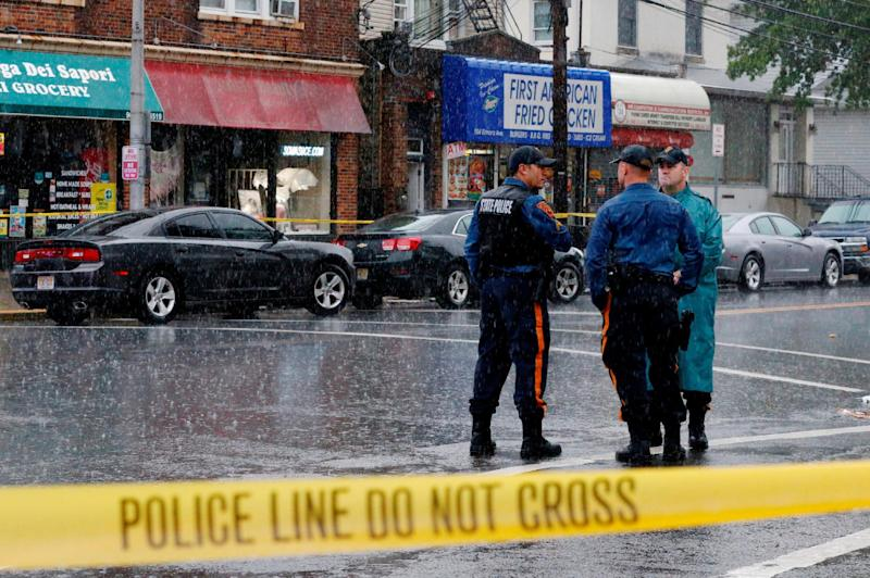 Police officers stand guard while law enforcement officers search an address during an investigation into Ahmad Khan Rahami, who was wanted for questioning in an explosion in New York, which authorities believe is linked to the explosive devices found in New Jersey, in Elizabeth. (REUTERS/Eduardo Munoz)