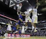 Kansas's Perry Ellis (34) puts up a shot during the first half of an NCAA college basketball game against the Kentucky, Tuesday, Nov. 18, 2014, in Indianapolis. (AP Photo/Darron Cummings)