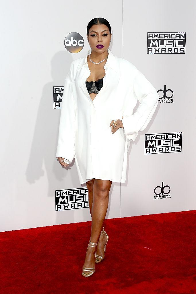 <p>Taraji P. Henson's oversized shirt dress showed off her black bra. For a pop of color with her monochrome ensemble, she had a magenta lip. <em>(Photo: Getty Images)</em> </p>
