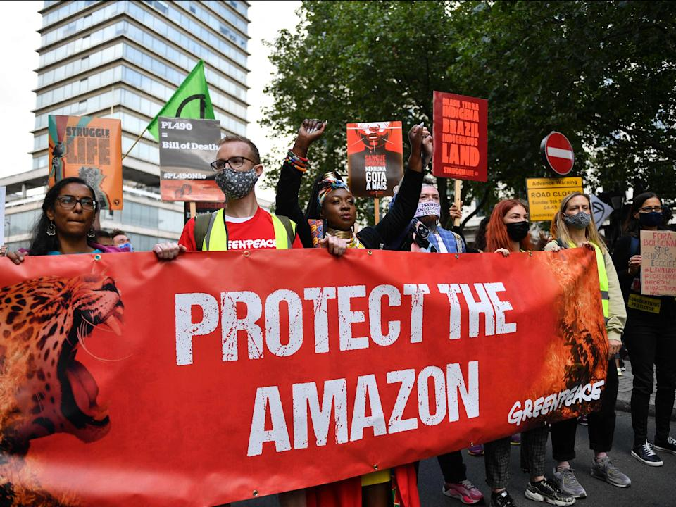 Activists from Greenpeace and other organisations joined XR protesters outside the embassy (AFP via Getty Images)