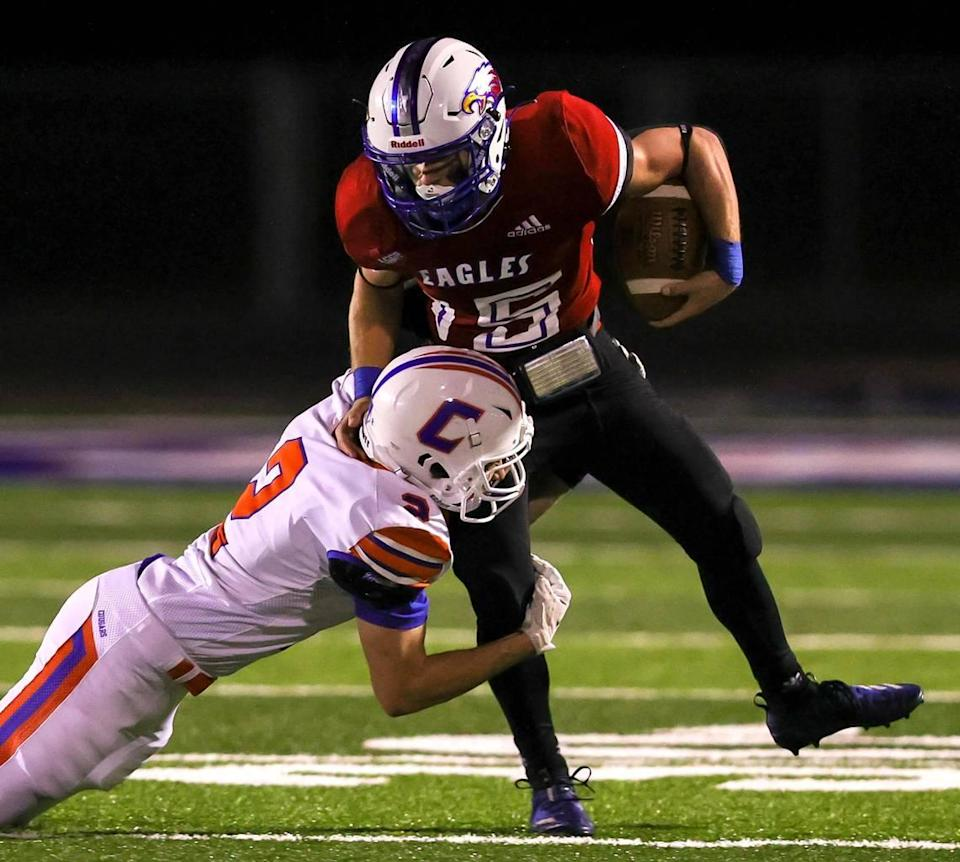 Lake Country running back Hayden Whites (15) tries to break free of Colleyville Covenant defensive back Daniel Calbrese (2) during the first half of a high school football game, October 30, 2020 played at Lake Country Christian School in Fort Worth, Tx. (Steve Nurenberg Special to the Star-Telegram)