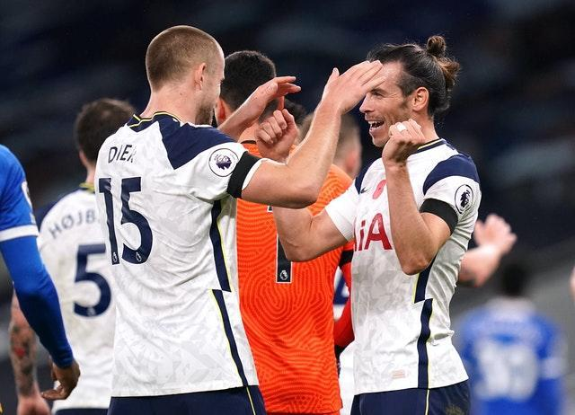 Erie Dier celebrates the win over Brighton with Gareth Bale