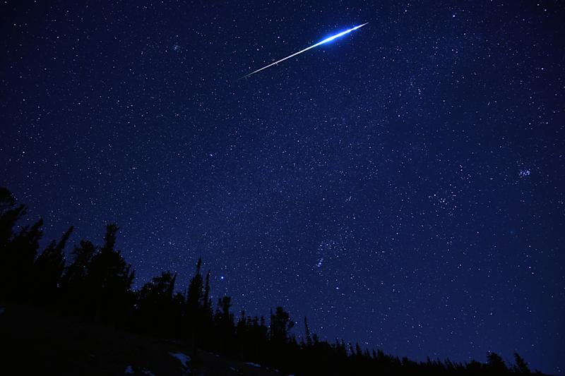 Picture of the Geminids Meteor shower in 2018, showing a meteor flash across the night sky.