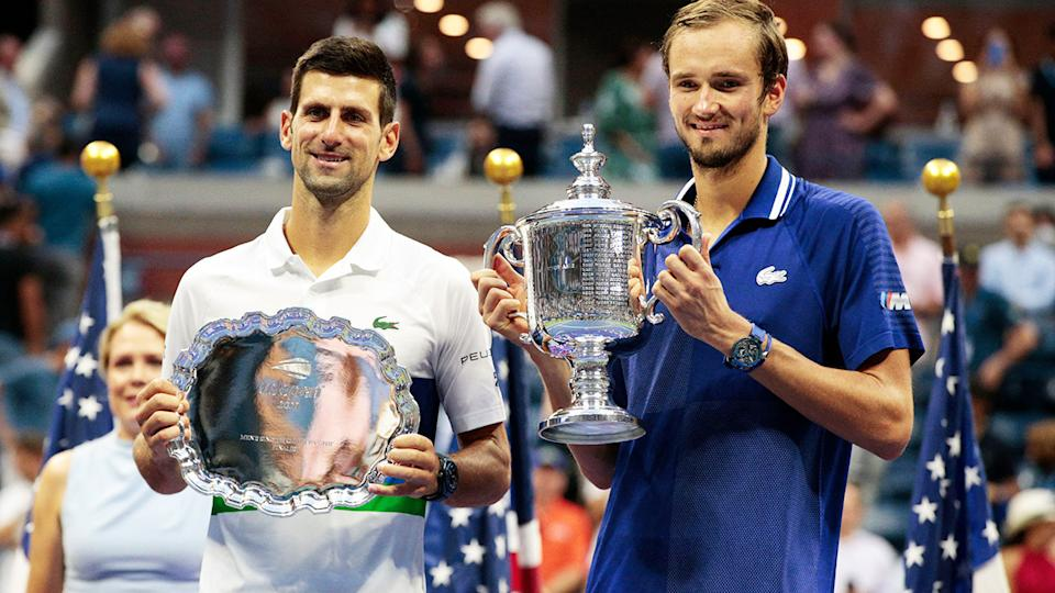 Novak Djokovic and Daniil Medvedev, pictured here with their trophies after the US Open final.