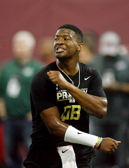 Jameis Winston reacts after completing a pass during pro day. (USA TODAY Sports)