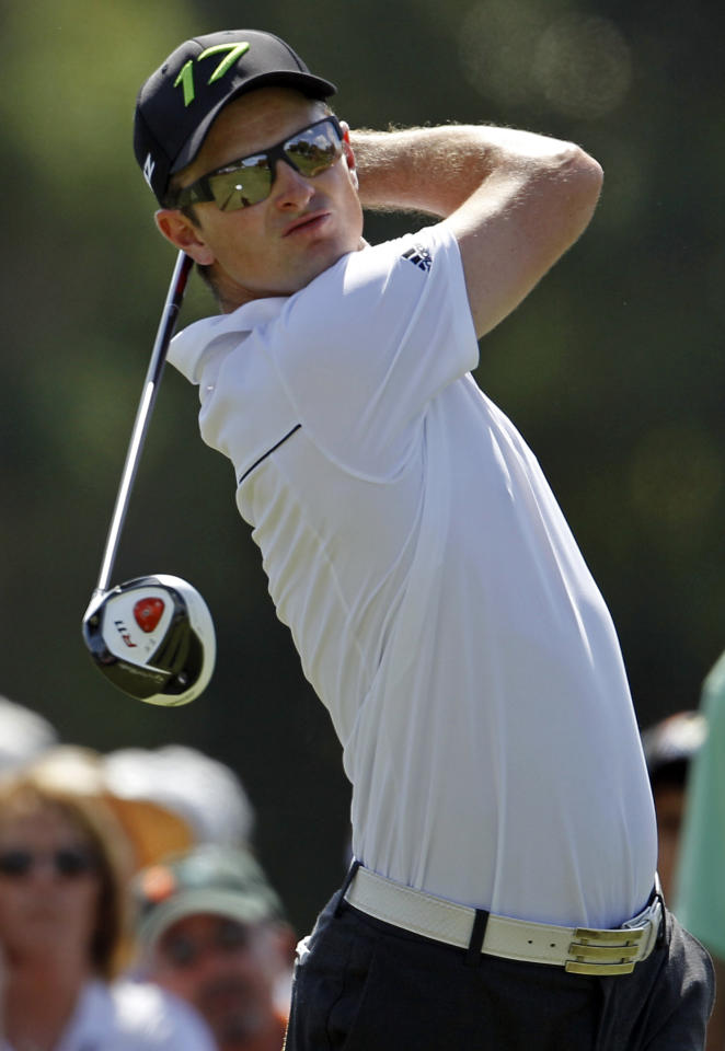 Justin Rose of England, hits from the second tee during the third round of the Cadillac Championship golf tournament on Saturday, March 10, 2012 in Doral, Fla. (AP Photo/Lynne Sladky)
