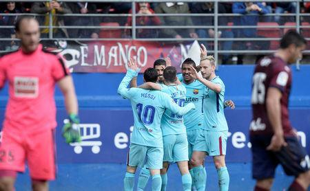 Soccer Football - La Liga Santander - Eibar vs FC Barcelona - Ipurua, Eibar, Spain - February 17, 2018 Barcelona's Luis Suarez celebrates scoring their first goal with Lionel Messi and team mates REUTERS/Vincent West