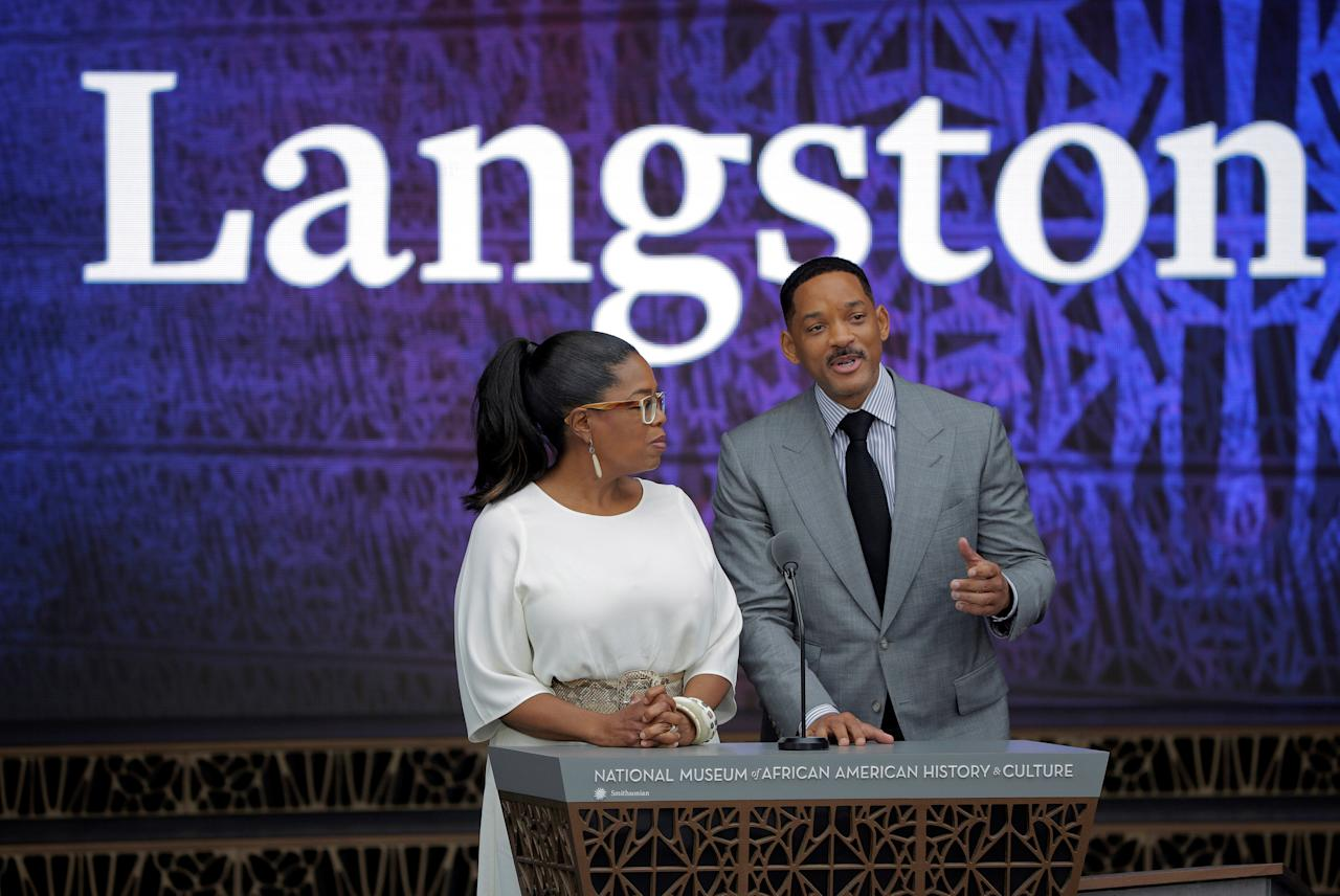 Actors Oprah Winfrey and Will Smith speak during the dedication of the Smithsonian's National Museum of African American History and Culture in Washington, U.S., September 24, 2016.      REUTERS/Joshua Roberts