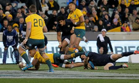 Rugby Union - Championship - Australia Wallabies vs Argentina Pumas - Canberra, Australia - September 16, 2017. Australia's Will Genia scores a try as Argentina's Nicolas Sanchez attempts a tackle. REUTERS/Jason Reed