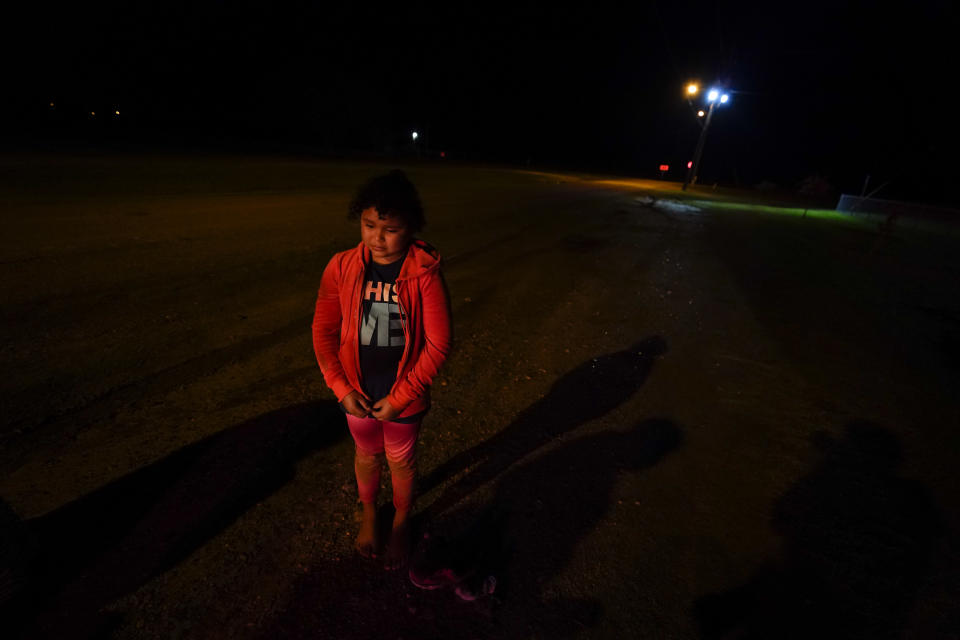 Emely, 8, of Honduras, waits at an intake area after turning herself in upon crossing the U.S.-Mexico border Wednesday, May 12, 2021, in La Joya, Texas. Growing numbers of migrant families are making the heart-wrenching decision to separate from their children and send them into the U.S. alone. (AP Photo/Gregory Bull)