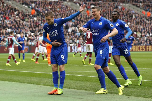 """<p>Britain Football Soccer – West Ham United v Leicester City – Premier League – London Stadium – 18/3/17 Leicester City's Jamie Vardy celebrates scoring their third goal with Robert Huth and Wilfred Ndidi Reuters / Peter Nicholls Livepic EDITORIAL USE ONLY. No use with unauthorized audio, video, data, fixture lists, club/league logos or """"live"""" services. Online in-match use limited to 45 images, no video emulation. No use in betting, games or single club/league/player publications. Please contact your account representative for further details. </p>"""