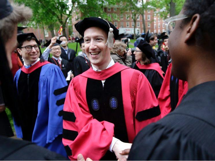 Mark Zuckerberg greets Harvard University graduates.