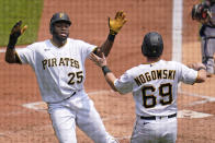 Pittsburgh Pirates' Gregory Polanco (25) celebrates with John Nogowski after both scored on an infield hit by Kevin Newman and a fielding error during the first inning of a baseball game against the New York Mets in Pittsburgh, Sunday, July 18, 2021. Three runs scored on the play. (AP Photo/Gene J. Puskar)