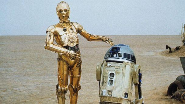 PHOTO: C-3P0, portrayed by Anthony Daniels, and R2-D2, portrayed by Kenny Baker, are seen in a scene from 'Star Wars: Episode IV - A New Hope.' (20th Century Fox/Lucasfilm)