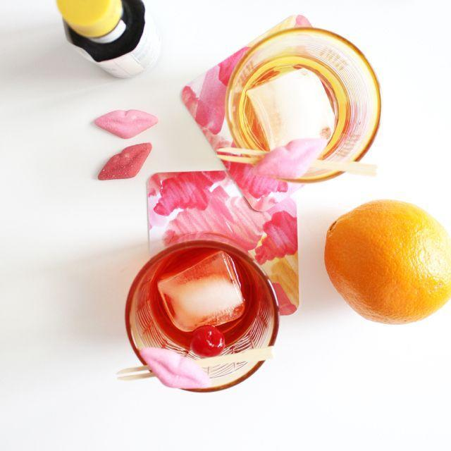 "<p>Candy lips make a playful addition to drink sticks, especially when paired with splashy pink coasters. Give your a date smooch—and your drink a brush of decor—by sliding gummy lips onto a wooden drink stick. </p><p><em>Via <a href=""http://www.sugarshoppelosangeles.com/"" rel=""nofollow noopener"" target=""_blank"" data-ylk=""slk:Sugar Shoppe LA"" class=""link rapid-noclick-resp"">Sugar Shoppe LA</a></em></p><p><a class=""link rapid-noclick-resp"" href=""https://www.amazon.com/Valentine-Multi-color-Mini-Solid-Chocolate/dp/B006XVD228?tag=syn-yahoo-20&ascsubtag=%5Bartid%7C10052.g.2387%5Bsrc%7Cyahoo-us"" rel=""nofollow noopener"" target=""_blank"" data-ylk=""slk:GET THE LOOK"">GET THE LOOK</a><br><em>Madelaine Chocolate Lips, Amazon, $11</em></p>"